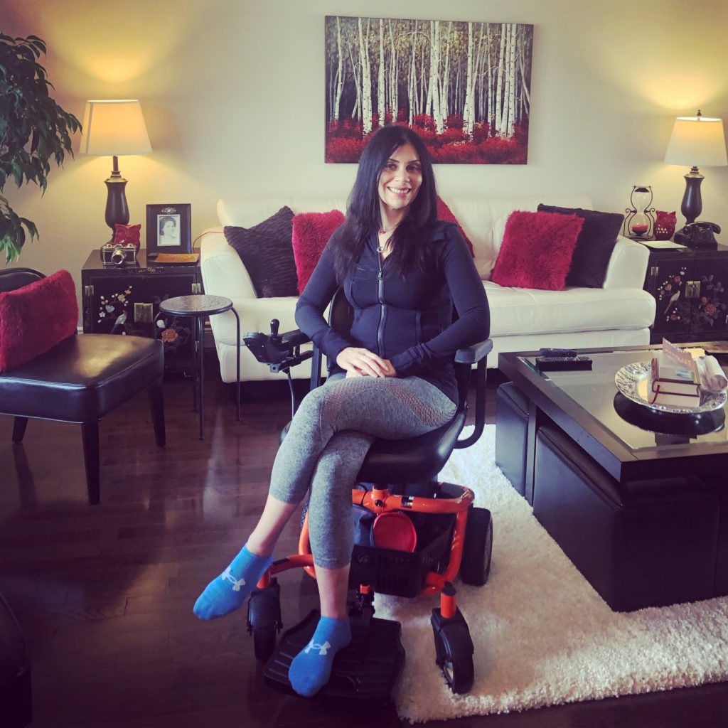 Anna In Her Golden LiteRider Envy Power Wheelchair