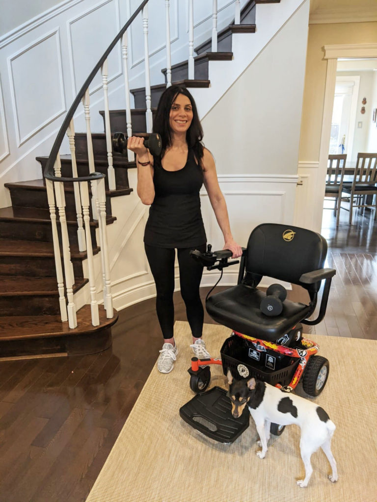 Anna Giannakouros Lifting Weights with Her Golden LiteRider Envy Power Chair