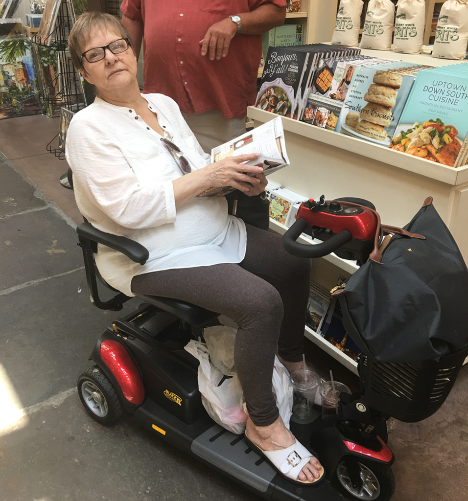 Sarahs Mom in a Golden Buzzaround XL Mobility Scooter