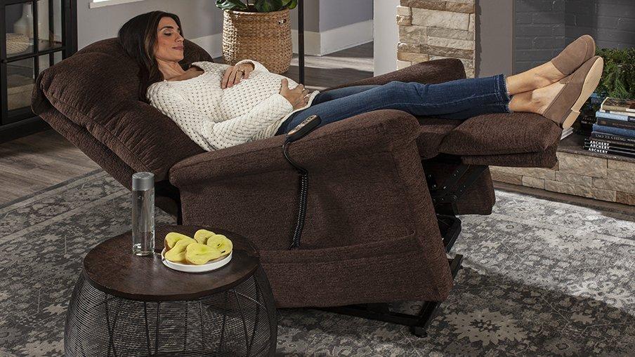 Pregnant Woman Sleeping in a Golden Zero Gravity Recliner