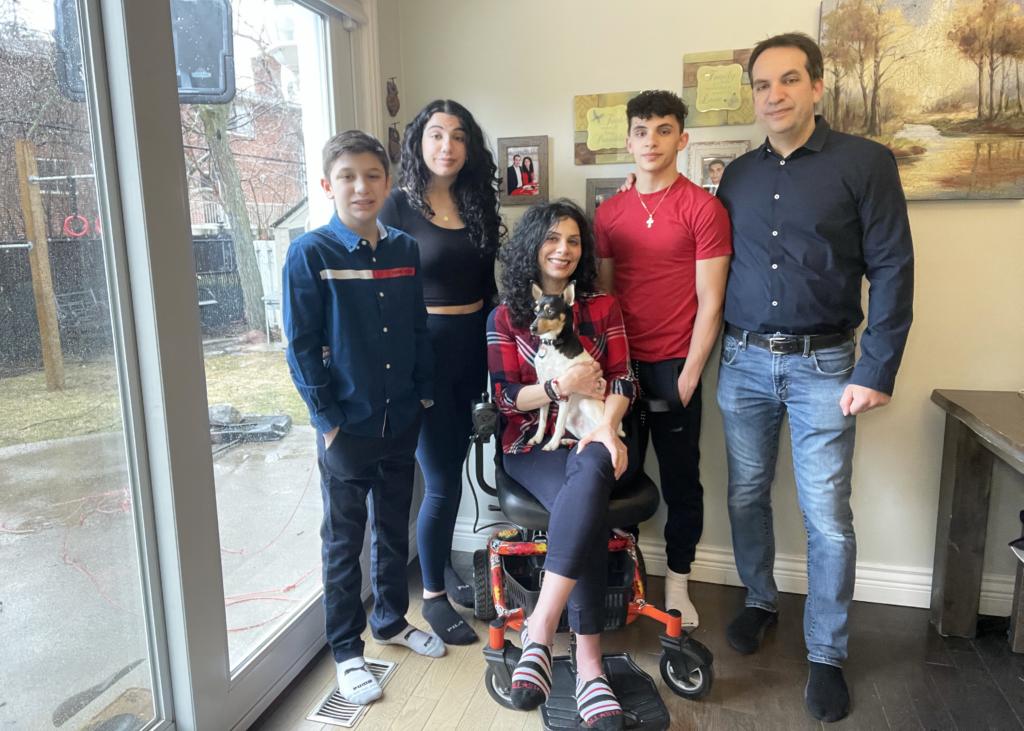 Anna Giannakouros on her Golden LiteRider Envy Power Wheelchair with her family