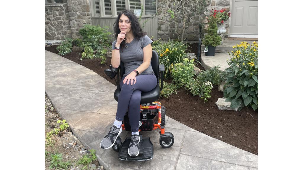 Anna Giannakouros with her Golden LiteRider Envy Power Wheelchair